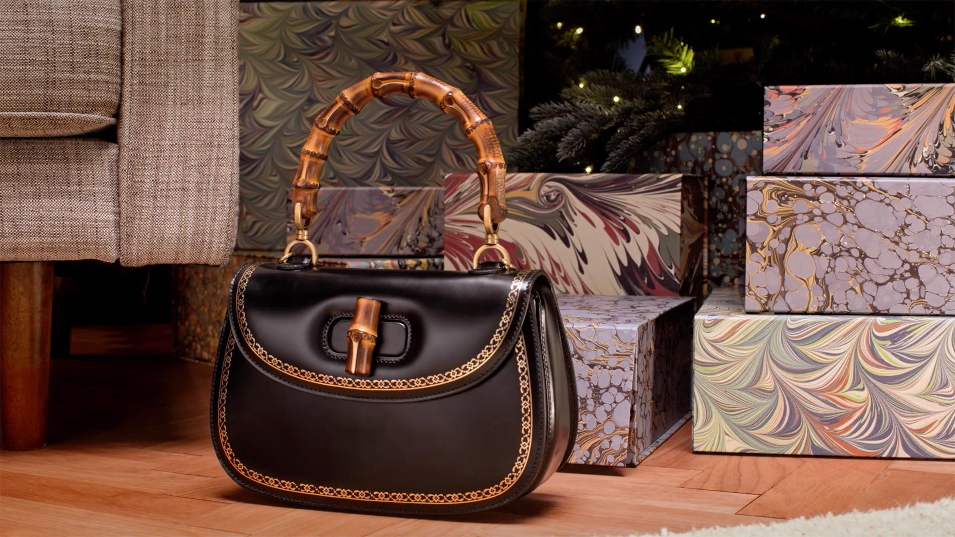 Gucci handbag pops out of a Christmas box for Matchesfashion