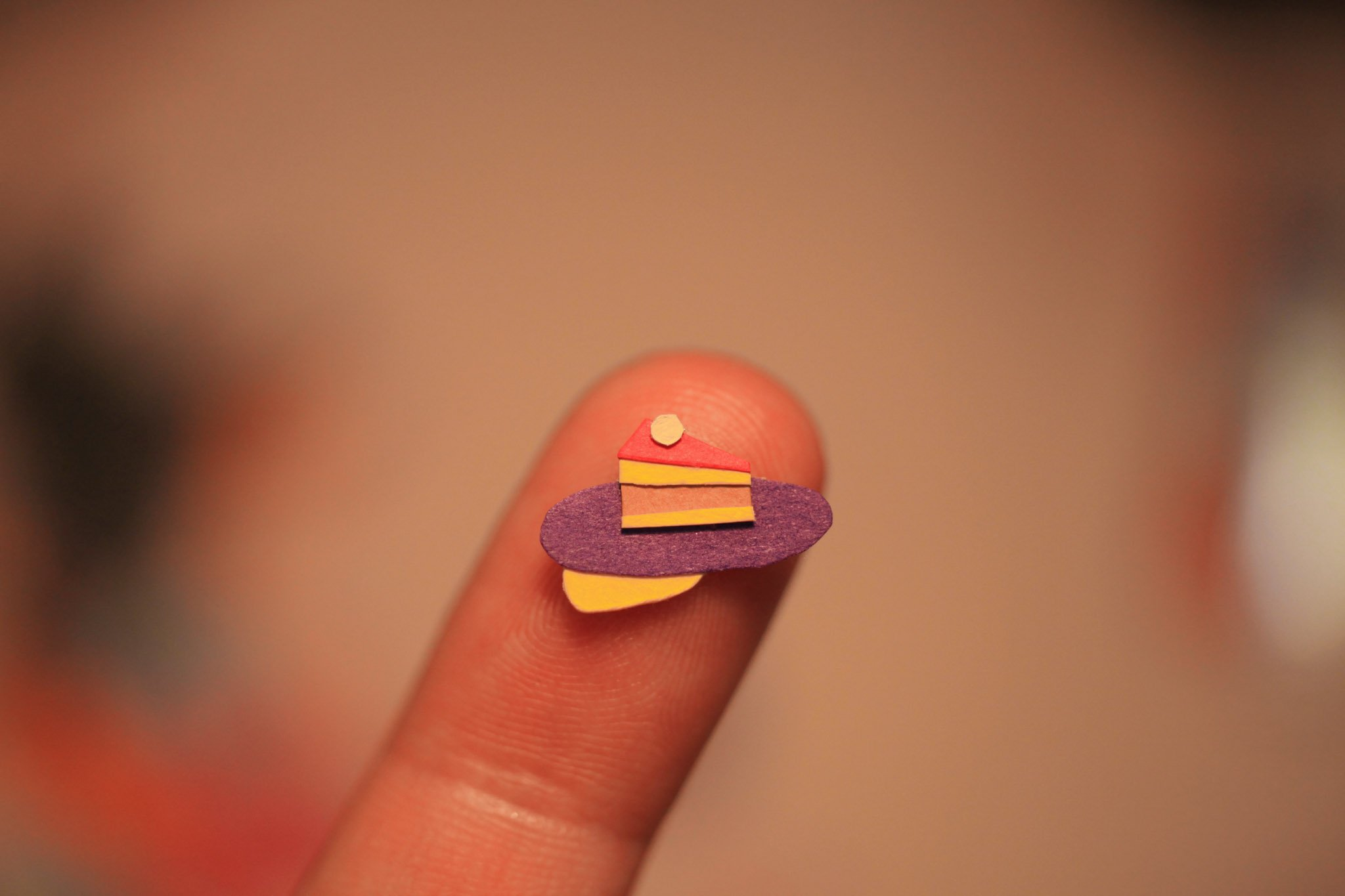 Paper cake on a finger tip